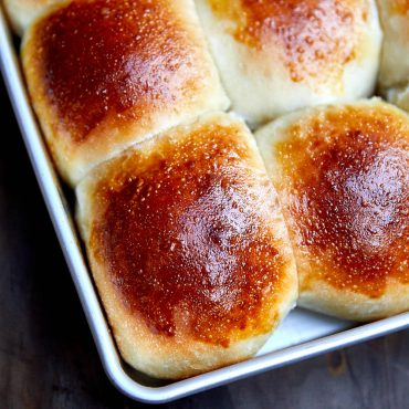 Golden brown yeast roll in a pan