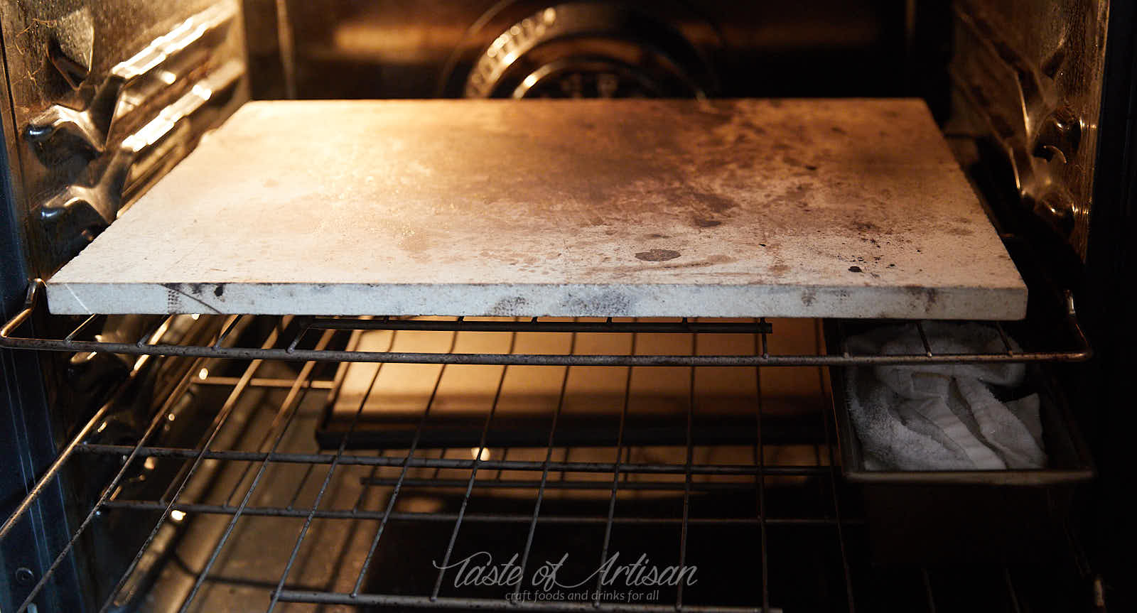 Baking stone and water pan preheating in the oven.