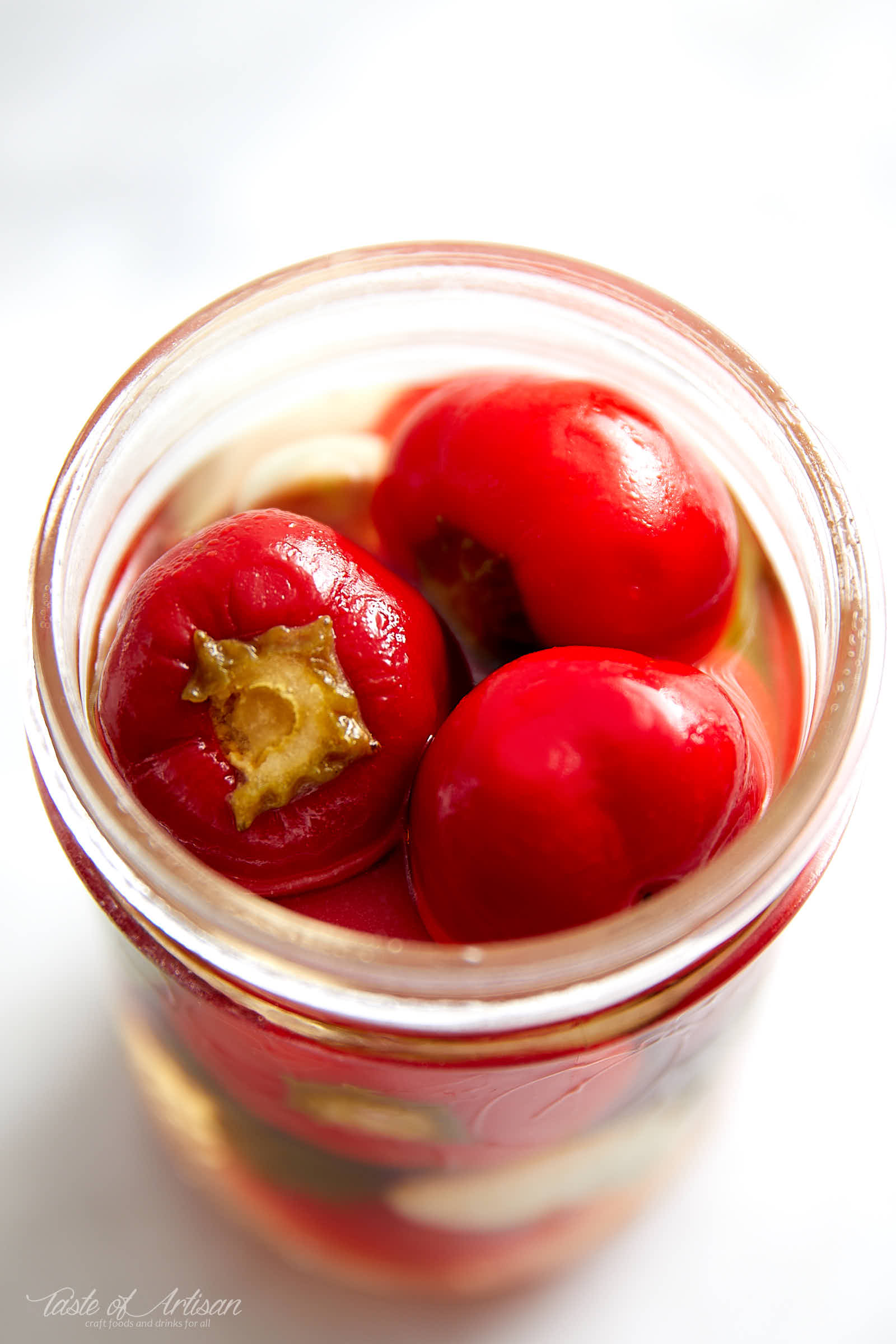 Cherry pepper pickled in a savory, with just a touch of sweetness, pickling liquid. These pickled cherry peppers are excellent with grilled and other meats. | Taste of Artisan