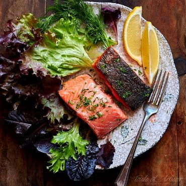 Sous Vide Salmon - cooked to perfection, tender, moist and very flavorful. A crispy skin adds a nice contrast to buttery soft fish texture. One of the best salmon recipes. | Taste of Artisan