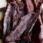 A pile of beef jerky on a table.