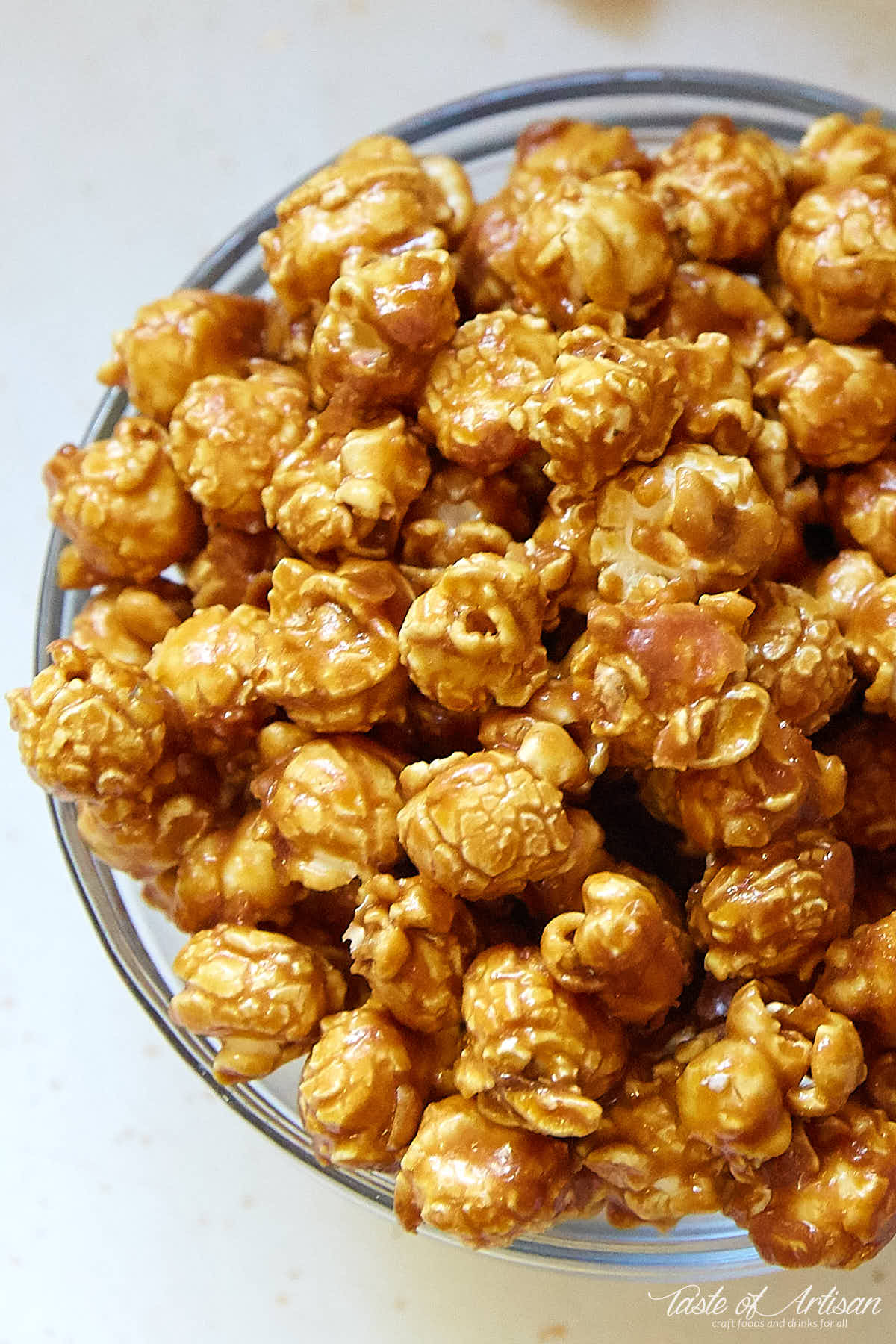 A bowl of homemade caramel popcorn, a top down view.