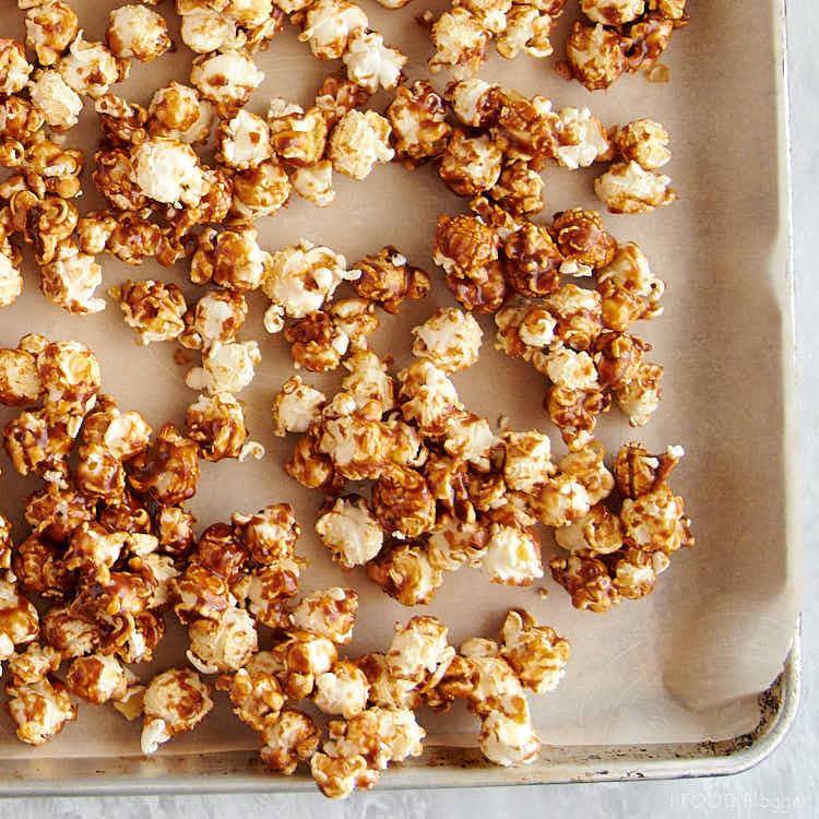 Caramel popcorn on a baking dish.