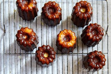 Caneles on a cooling rack, bottoms up.