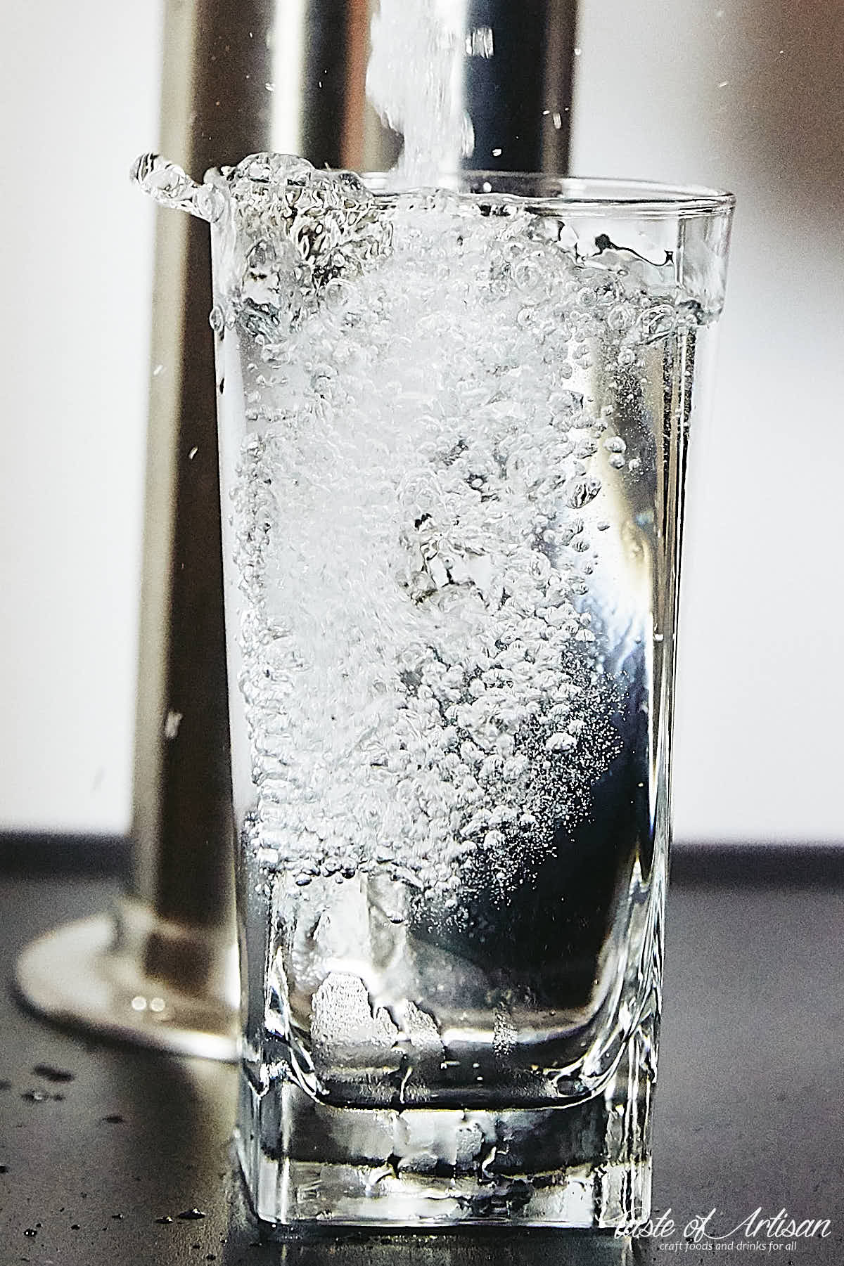 Home carbonated water poured in glass