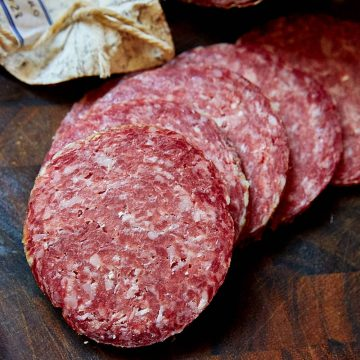 Slices of salami Milano on a cutting board.
