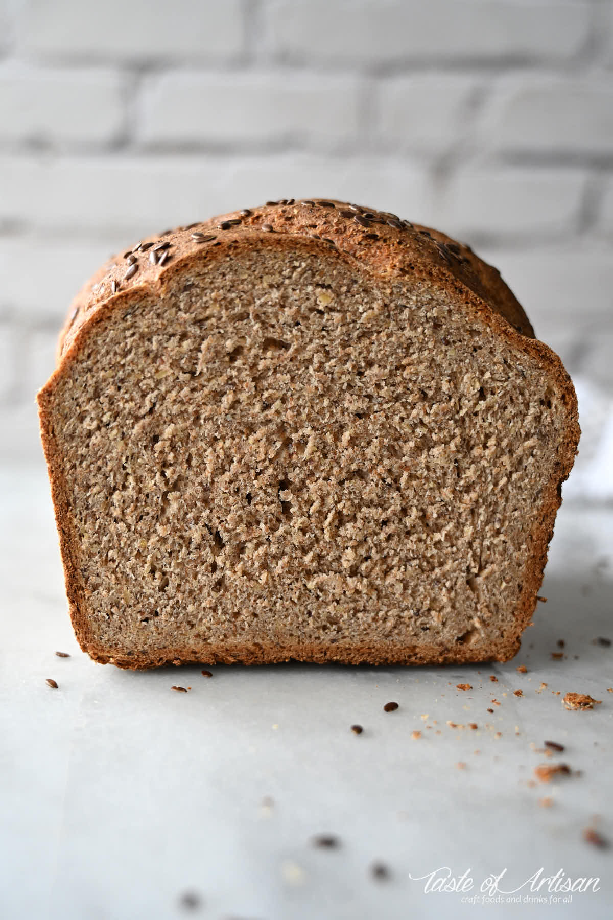 Flaxseed bread loaf cut in half, view of crumb.