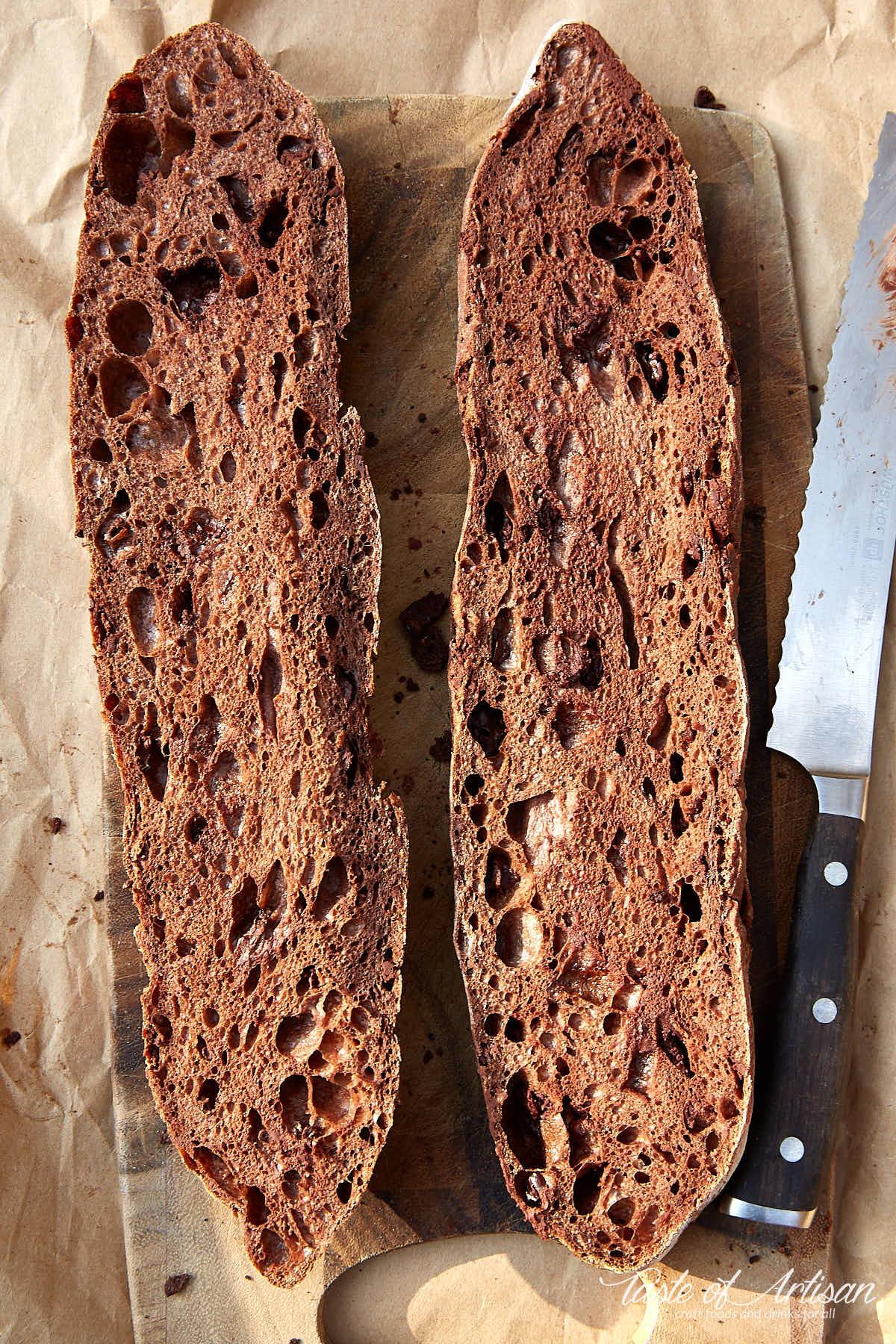 Chocolate baguette cut in half, beautiful crumb visible.