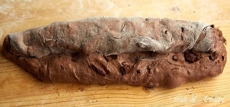 Rolling chocolate baguette dough.