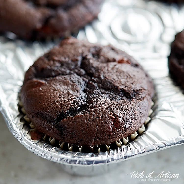 Chocolate cherry cupcake in a muffin pan.