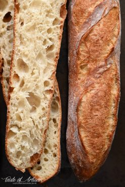 Close up of French baguette crumbs and crispy crust.