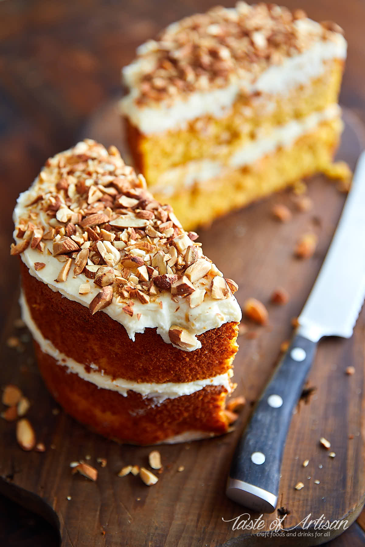 Gluten free carrot cake with cream cheese frosting cut in half.