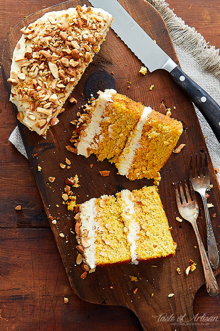 Slices of gluten-free carrot cake on a cutting board.