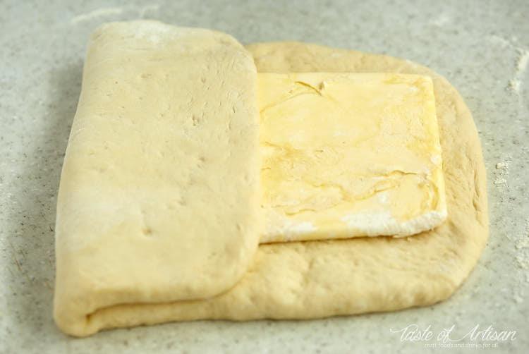 Dough folded over butter rectangle laminating for croissants.