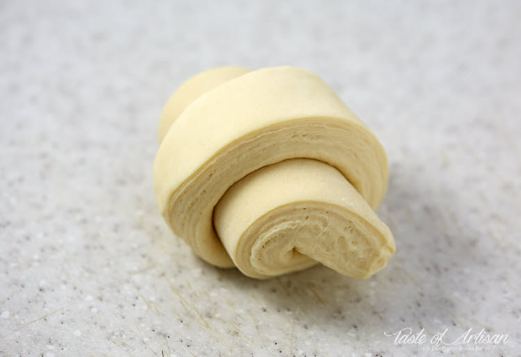 Croissants rolled up before baking.