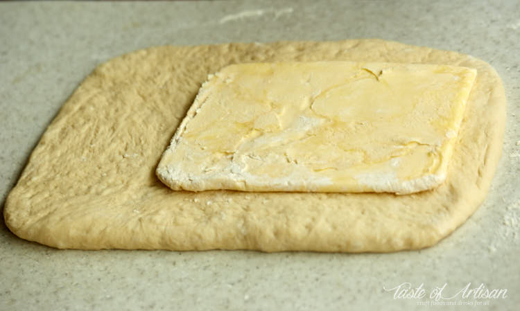 Butter on dough ready for lamination.