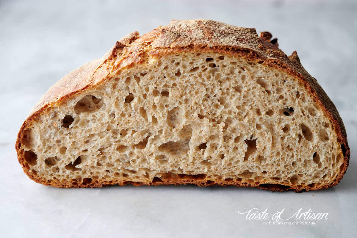 No-knead bread loaf, overnight retarding, nice open crumb,.