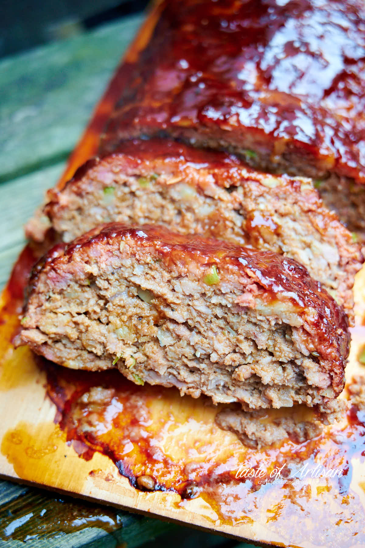 Slice meatloaf on a wooden board.