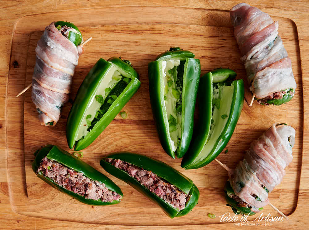 Stuffing jalapeno peppers with chopped brisket, cream cheese and wrapping in bacon.