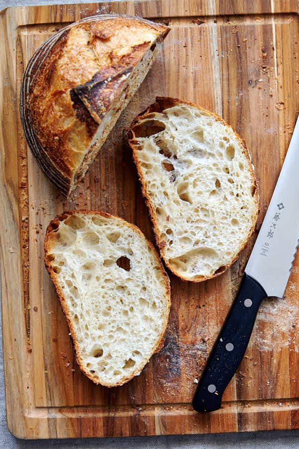 Sliced sourdough bread on a cutting board.