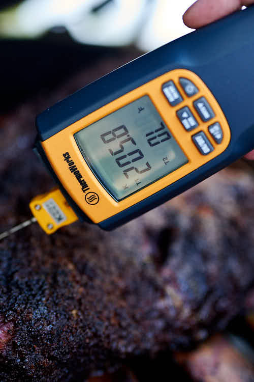 Checking beef short rib temperature with a thermometer.