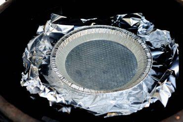 Water pan inside smoker.