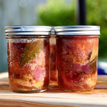 Cooked beef in mason jars.