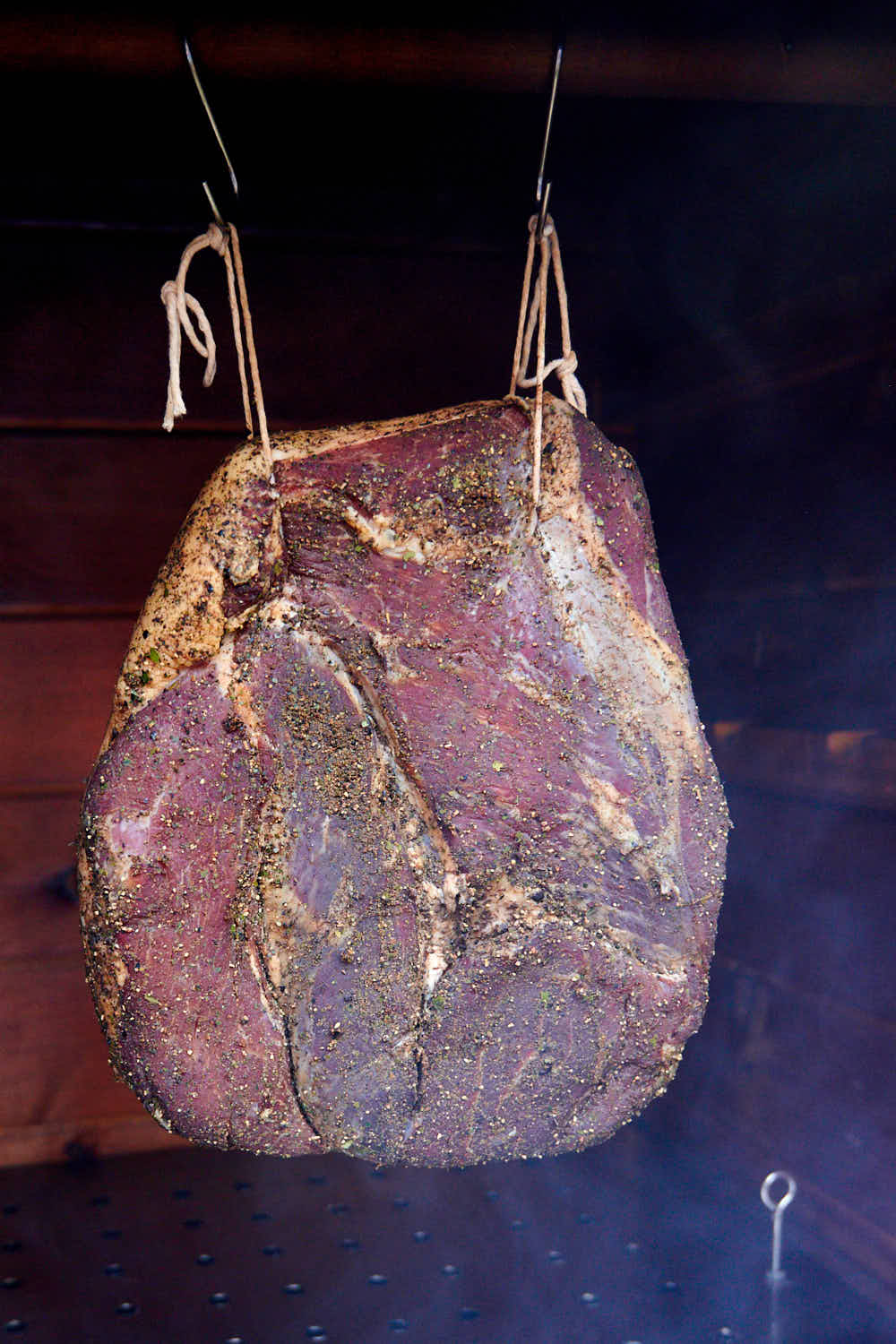 Cold smoking meat in a smokehouse