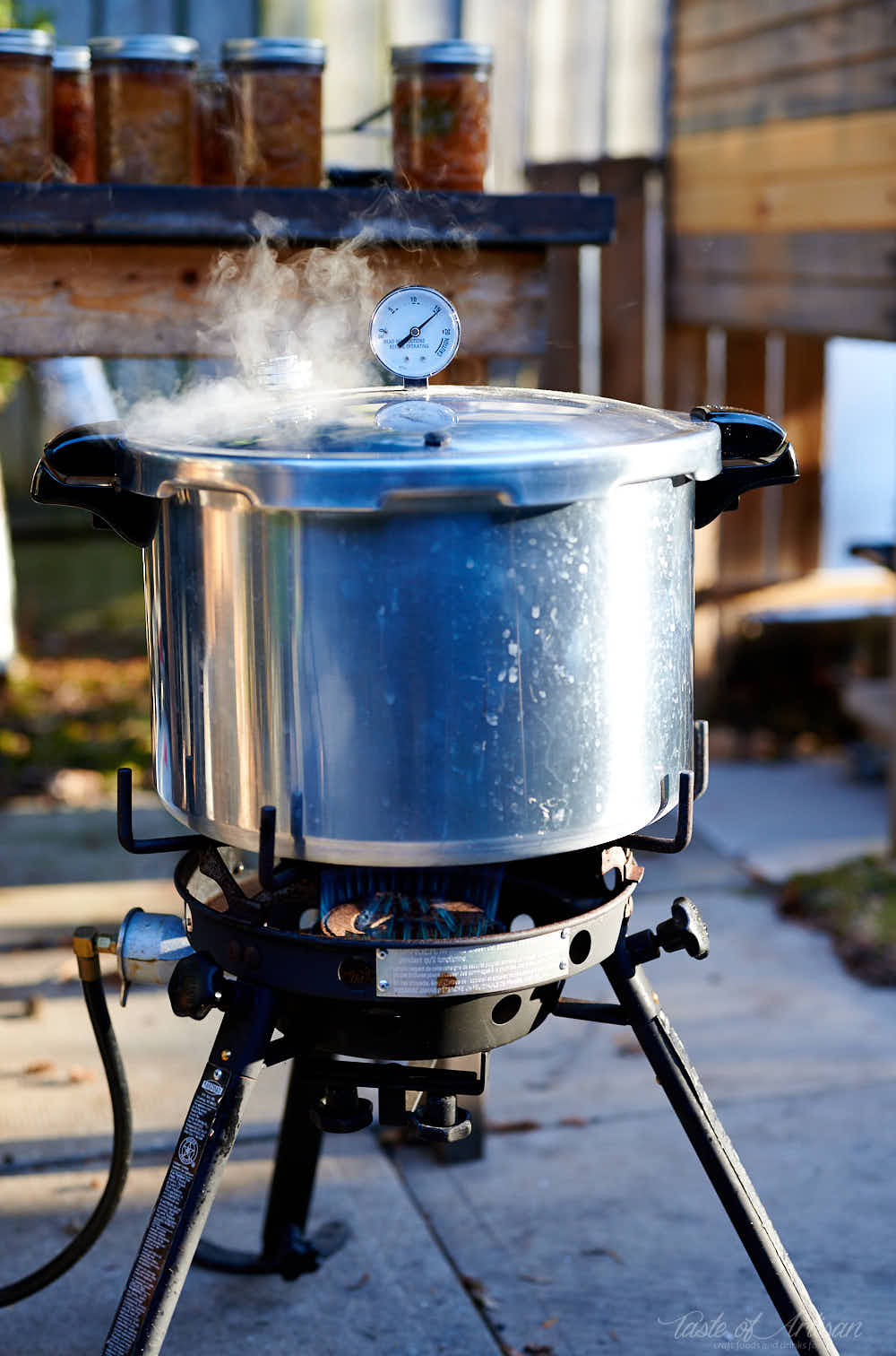 Steaming meat canner on gas burner.