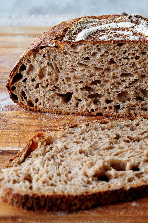Sourdough bread cut in half, showing a nice open crumb.