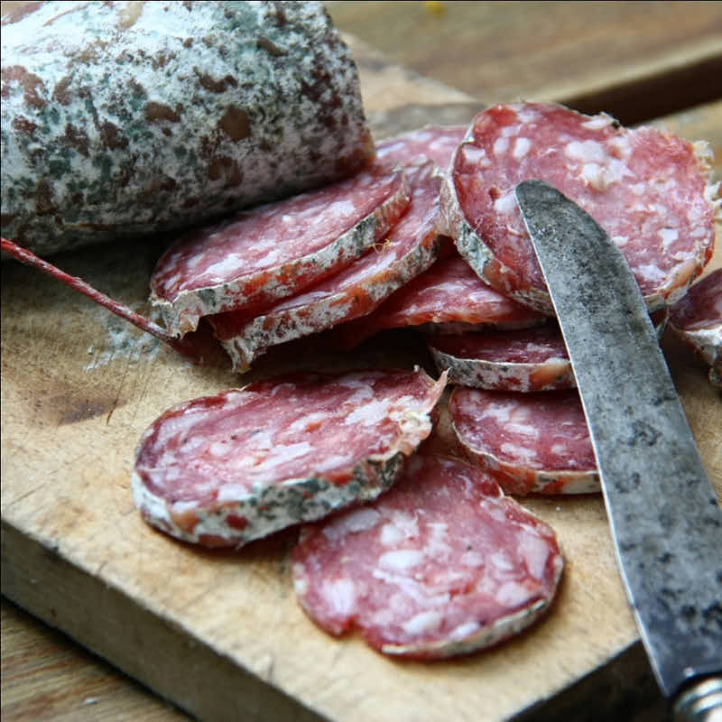 sliced salami with green mold
