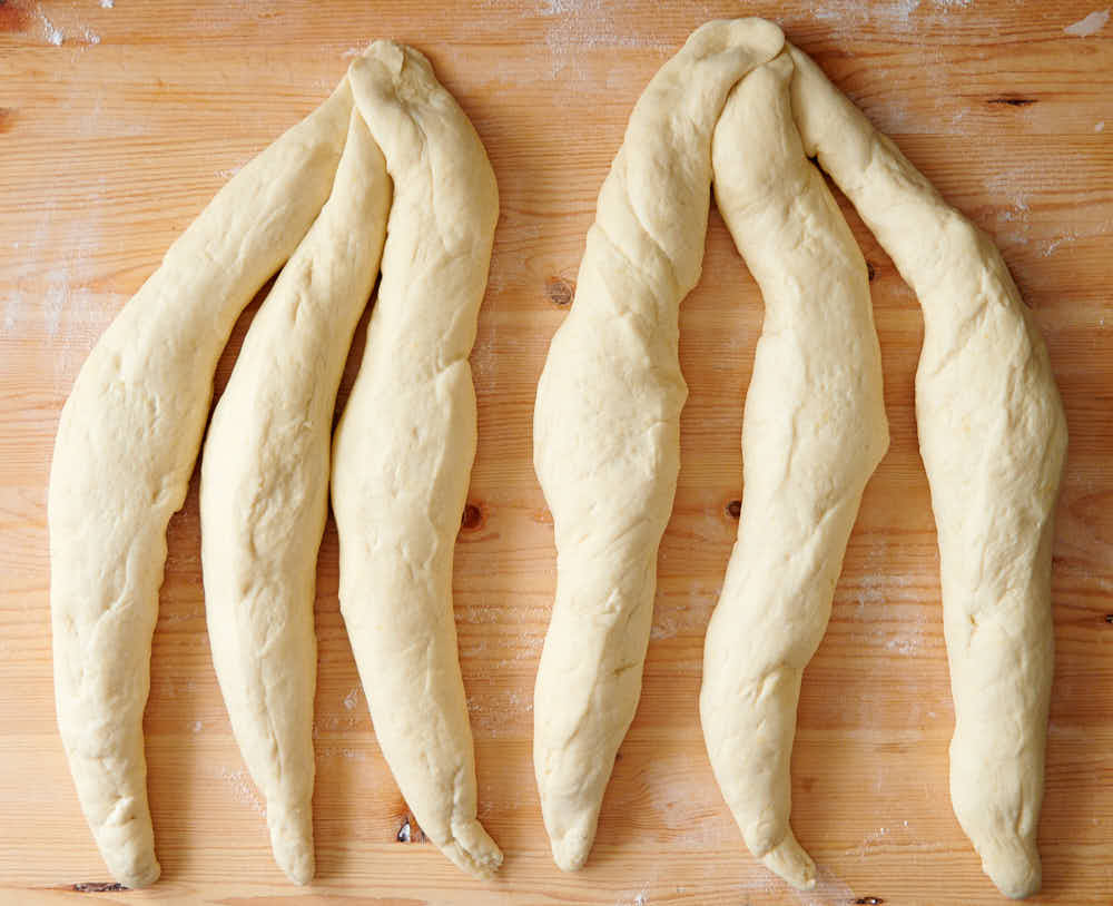 Six strands of dough to make challah bread.