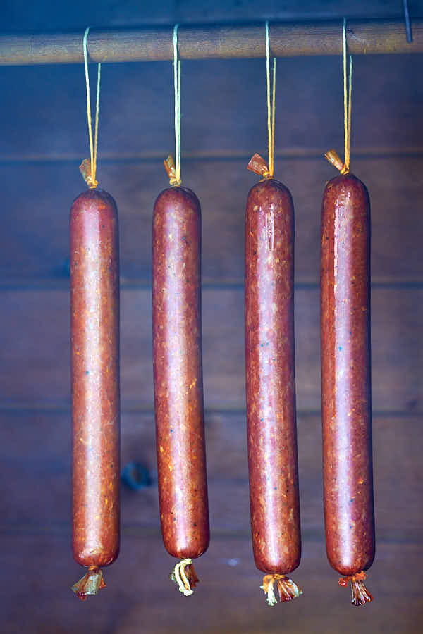 Pepperoni sausage in a smokehouse.