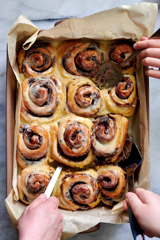 Sticky, moist sourdough cinnamon rolls in a pan.