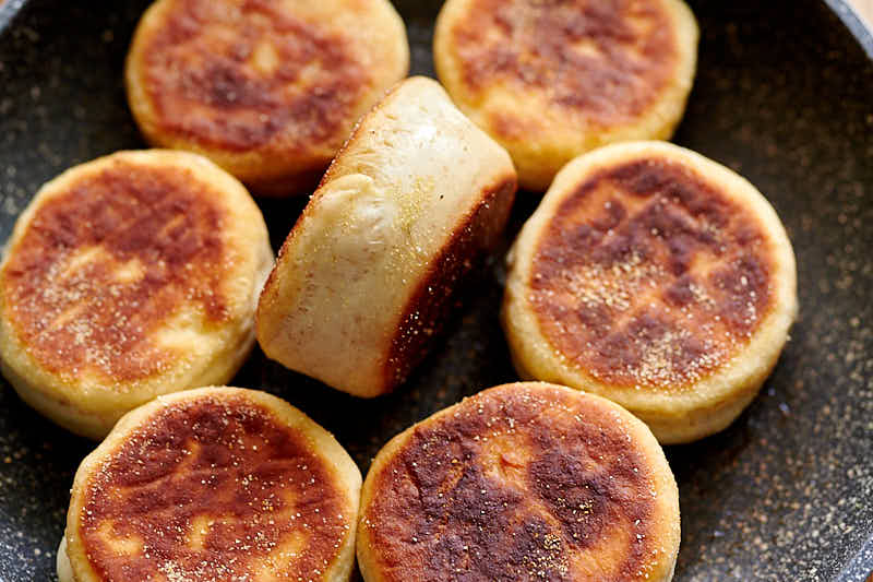 Sourdough English muffins on a frying pan