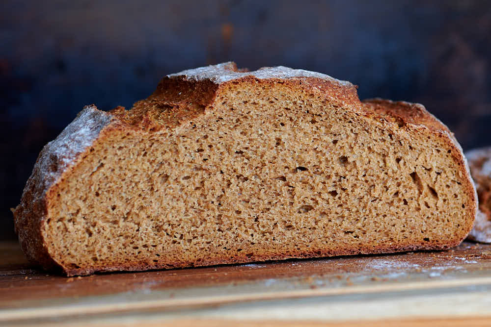 Open, airy crumb of sourdough rye bread.