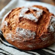 Sourdough rye bread on a kitchen towel.