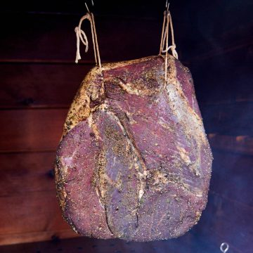 Speck smoking in a smokehouse