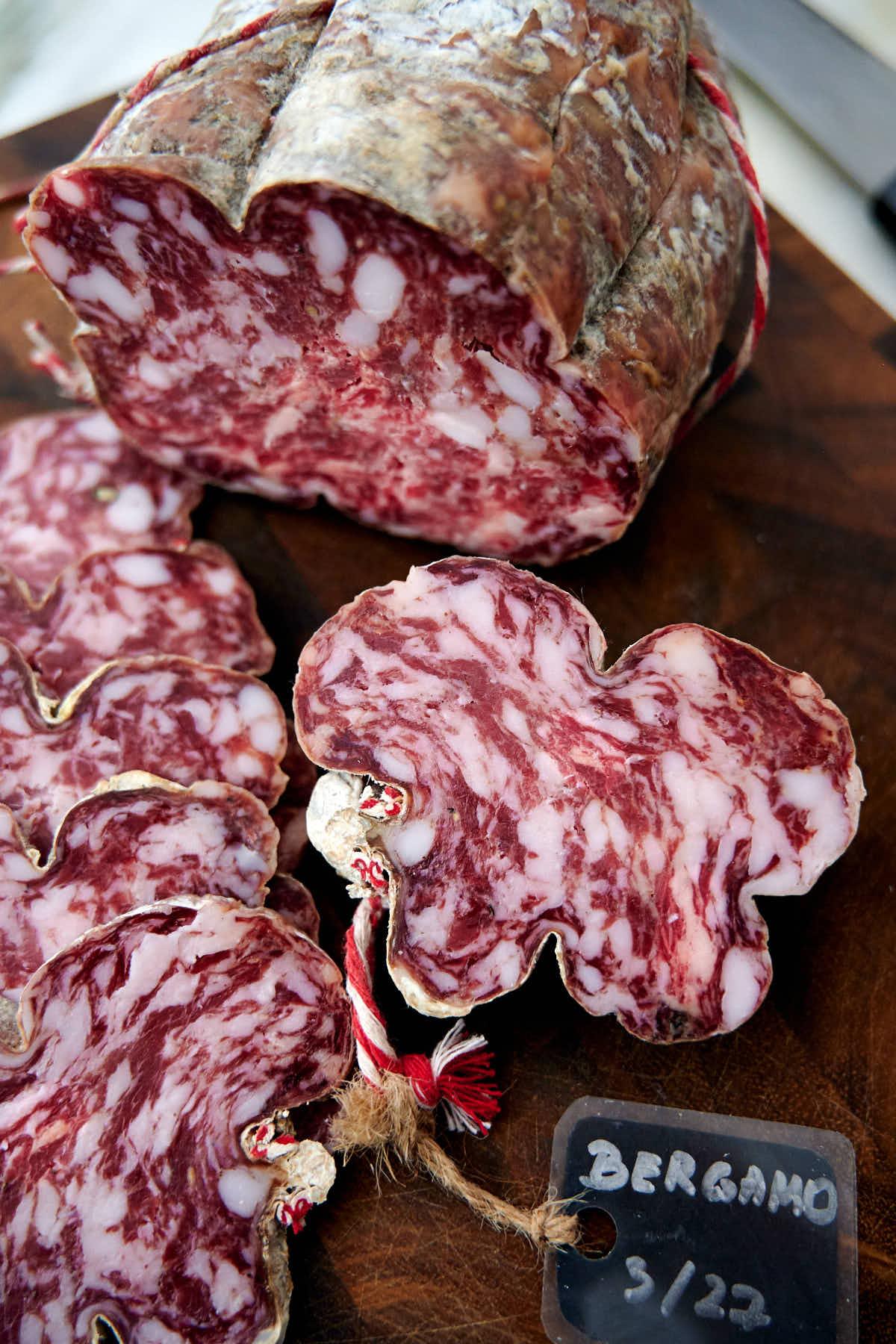 Sliced homemade salami Bergamo.