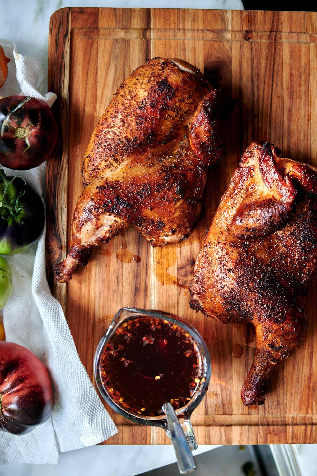 Smoked chicken halves served with apple cider vinegar sauce.