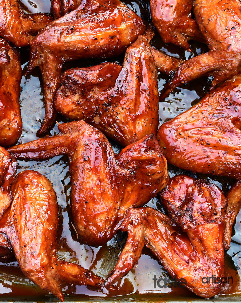 Extra crispy smoked chicken wings glazed with BBQ sauce.