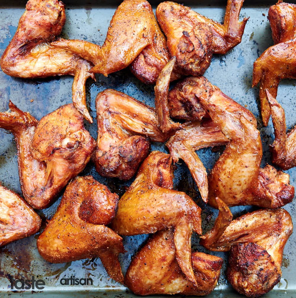 Extra crispy smoked chicken wings first smoked low and slow then deep-fried until perfect crispiness.