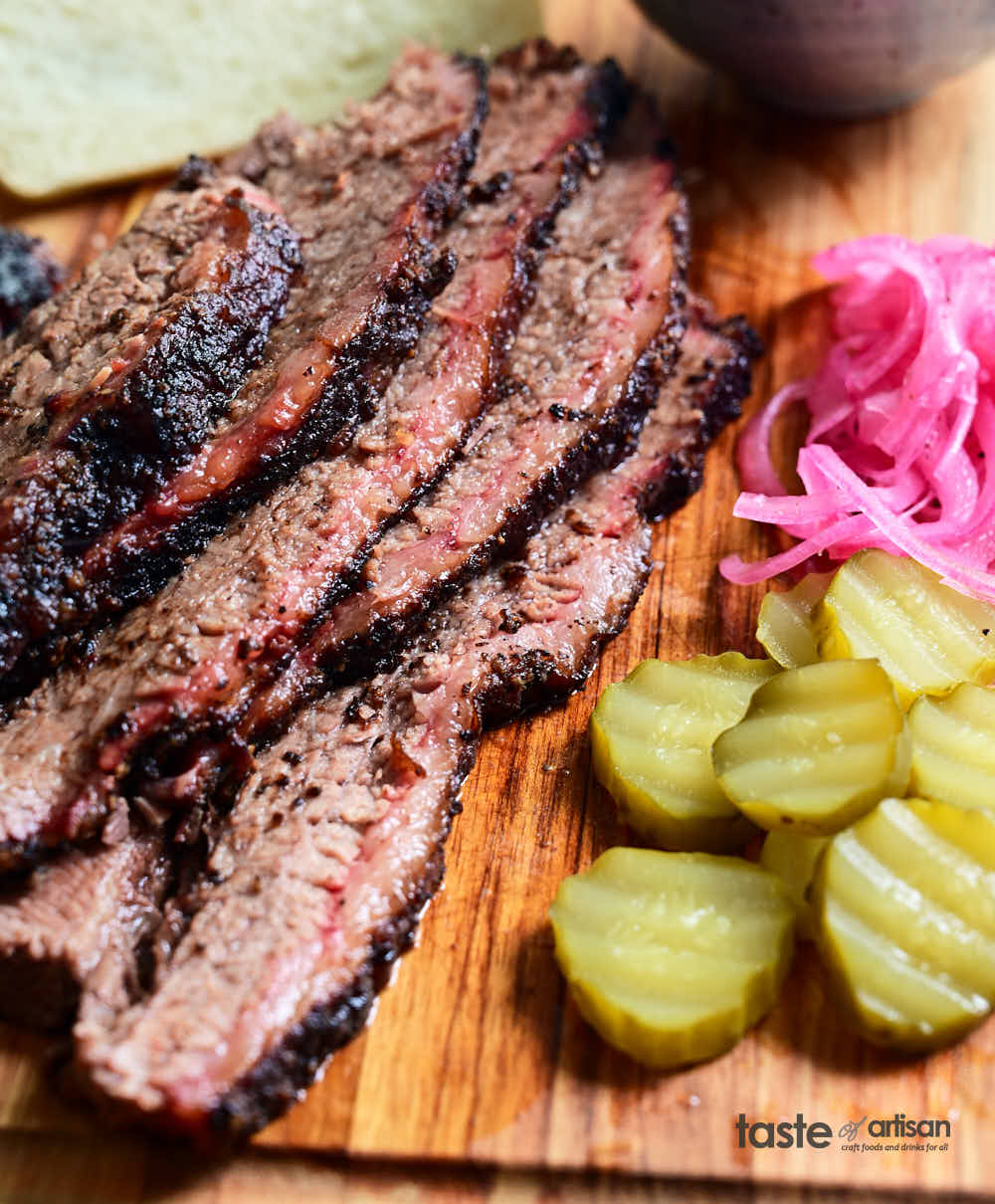 Juicy, tender, moist slices of smoked brisket with condiments