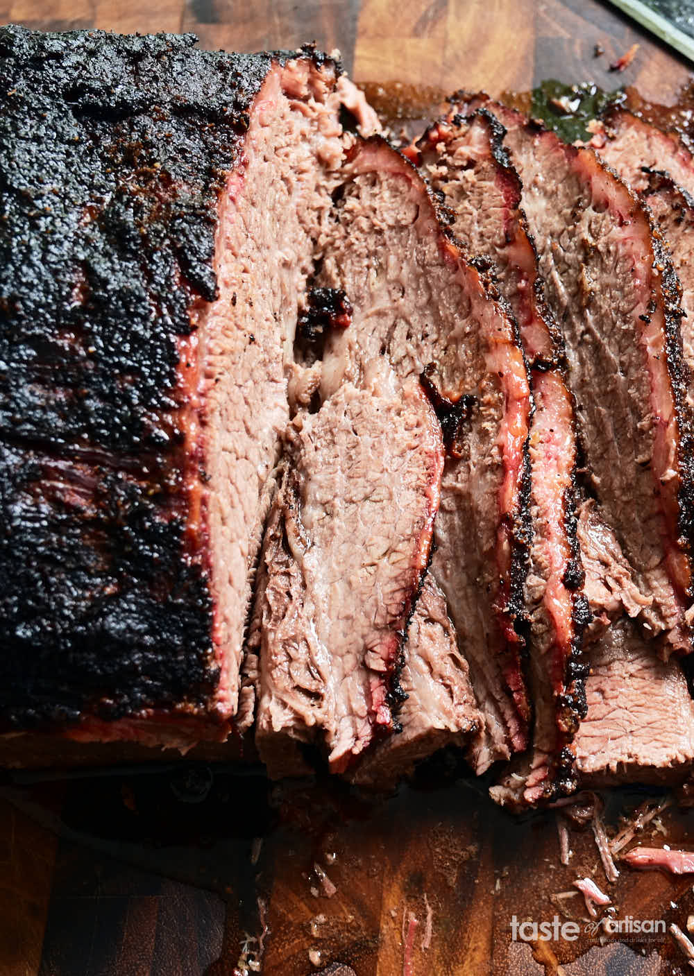 Super juicy smoked brisket slices on a cutting board